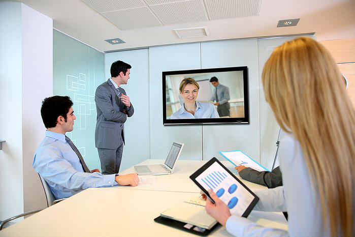 Business people attending videoconference meeting-1