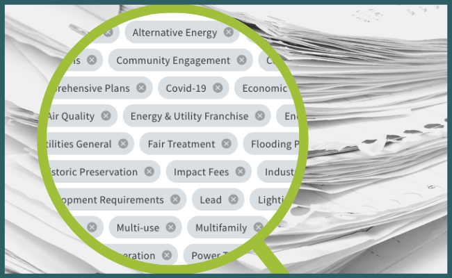 magnifying glass highlighting local issues that legislative tracking software can find in local government documents